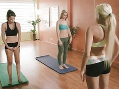 Busty yoga trainer teaching techniques